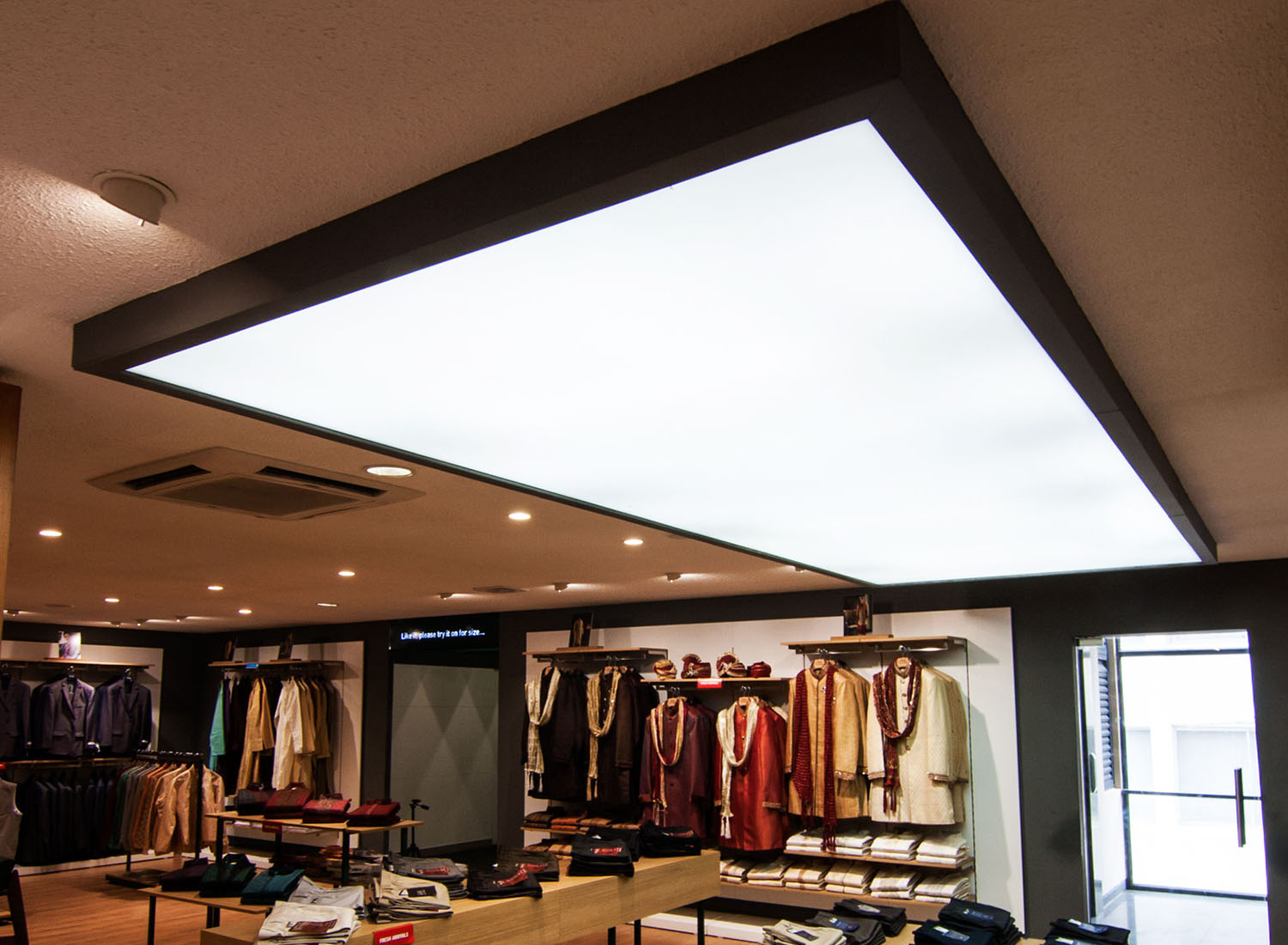 Peter England - Stretch Ceiling  Translucent with Backlighting in Showroom - Showroom